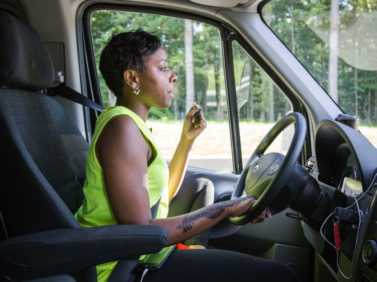 Kristal Bush chews on sunflower seeds to keep alert on the long drive to Huntingdon, Pennsylvania. Bush is the founder of @BridgingTheGapLLC transportation company. Several times a week, her vans pick up riders from their homes throughout Philadelphia and drive them to see loved ones in prisons across the state.