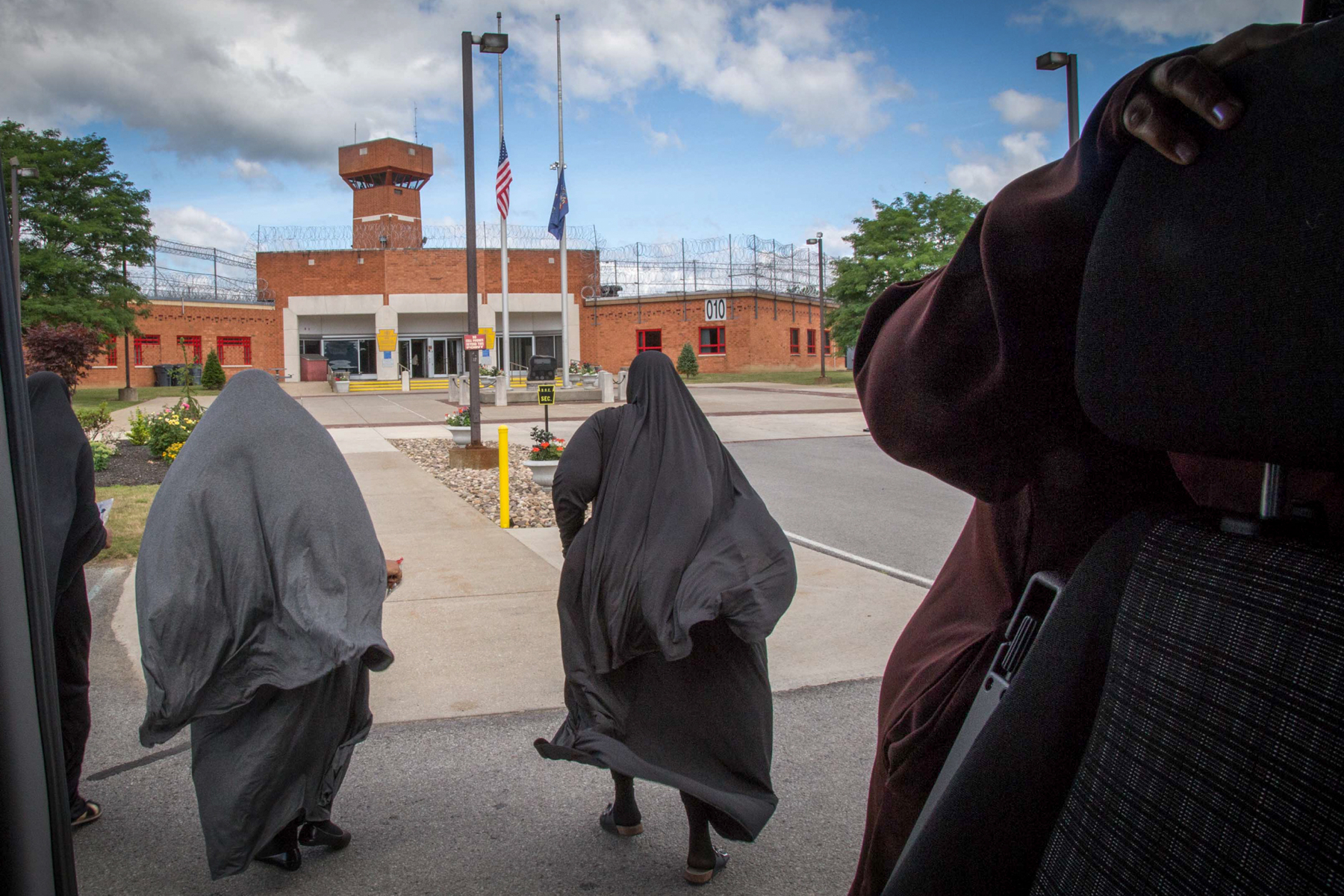 Aisha, Tysheen and Tanesha run toward the doors of Smithfield prison, not wanting to waste a moment of their visiting day. The vans drop off between 9 a.m. and 10 a.m., and return when the visits let out between 3 p.m. and 3:30 p.m.