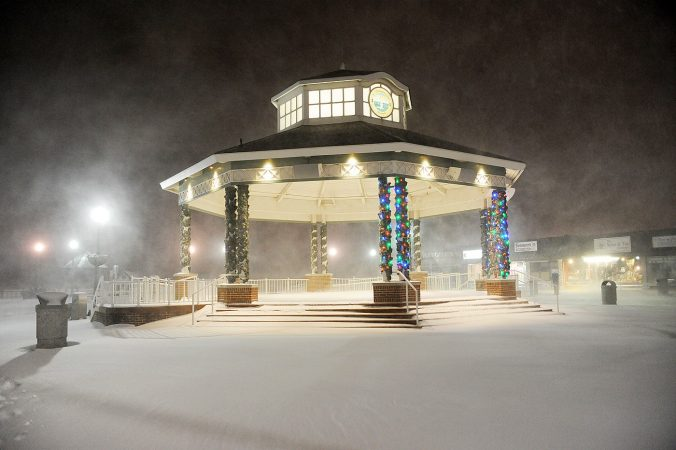 Swirling snow is illuminated by Christmas lights around the Rehoboth Beach bandstand. (Chuck Snyder/for WHYY)