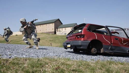 Members of the Pennsylvania National Guard participate in a battle simulation during Exercise Red Rose, Friday, April 2, 2010, at Fort Indiantown Gap in Annville, Pa.  (Carolyn Kaster/AP Photo)