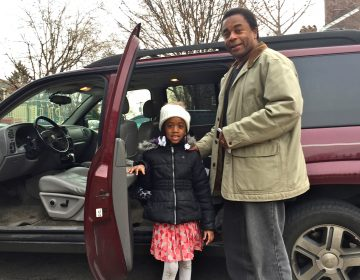 Waliyyuddin Abdullah drops off daughter Florrie, a first grader, at Powel School in West Philadelphia. Abdullah chose Powel over his neighborhood school in North Philadelphia.