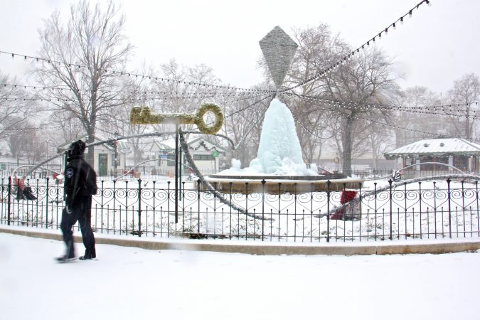 The fountain at Franklin Square Park in Philadelphia forms an abstract ice sculpture as water continues to bubble up into the freezing air.