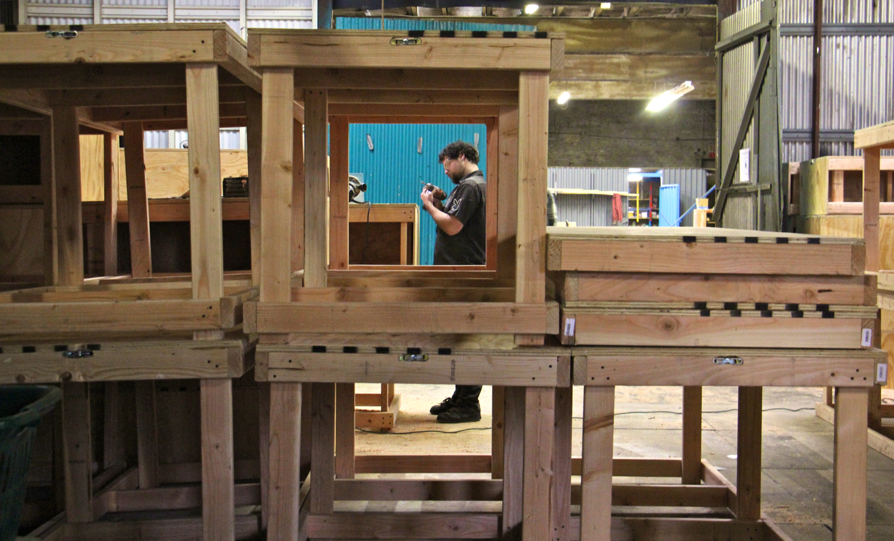 "Evan Abrams works on the modular components of the set for EgoPo's production of the ""Lydie Breeze Trilogy."" The 10,000-square-foot Philadelphia Scenic Works allows small theater companies to tackle big projects."