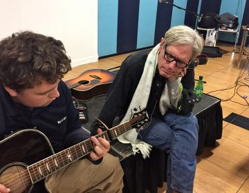 Singer/songwriter Sam Baker (right) sits with 16-year-old Andrew Hart, who suffers from severe depression, and has struggled with homelessness and abuse. He taught himself to play the guitar.