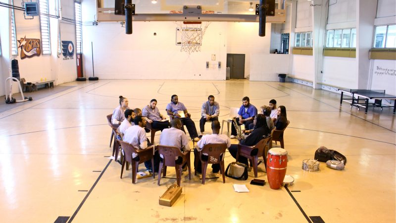 Inmates at Philadelphia Detention Center meet with Hannibal Lokumbe in the prison gym for music and soul searching. (Emma Lee/WHYY)