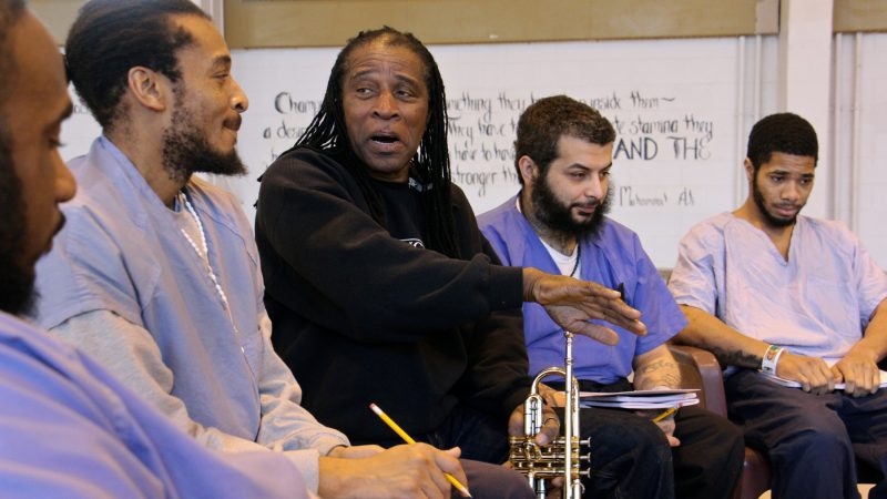 Philadelphia Orchestra composer-in-residence Hannibal Lokumbe meets with inmates at Philadelphia Detention Center, an experience that will inform his work. (Emma Lee/WHYY)