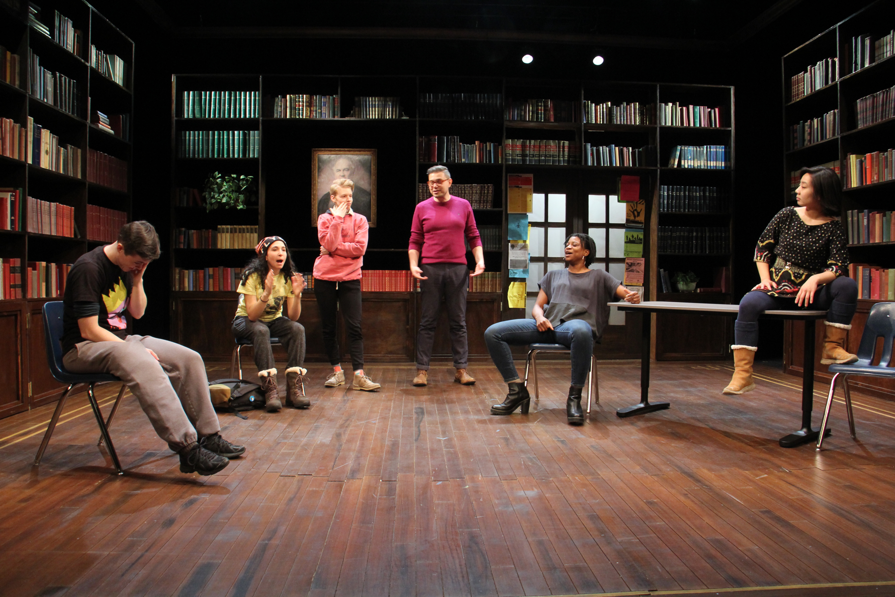Director Evren Odcikin (center) joins cast members on stage during rehearsal as they take on their male roles.