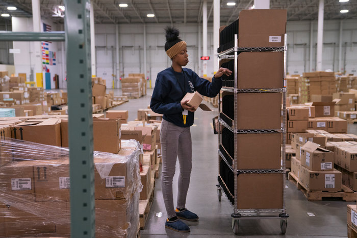 "Alvine Bunch, 23, used to work at Amazon as a picker, but now does the same work at Radial. She says she does expect more robots in warehouses of the future ""but not to the point whereas there's just no work to do."""