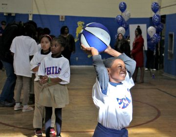 Hartranft fourth-grader Terrsir Smith enjoys a basketball clinic put on by the Philadelphia 76ers at his school, a reward for positive behavior.