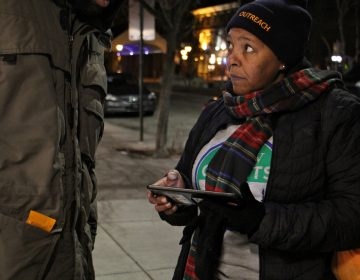 Monique Taylor interviews a homeless man near Headhouse Square for the 2018 homeless census. Like many of the volunteers who fanned out across the city Wednesday night, Taylor has experienced homelessness.