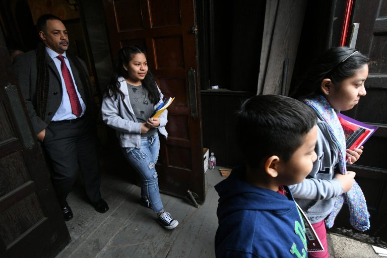 The four undocumented children of Camela Apolonio Hernandez step out of their sanctuary at Church of the Advocate in North Philadelphia, heading back to school for the first time since the family received a deportation order.