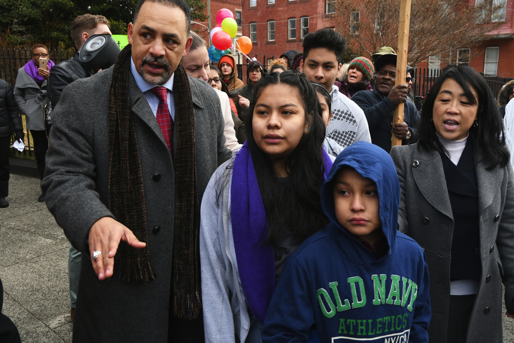 State Rep. Chris Rabb and Councilwoman Helen Gym walk with the four undocumented children of Camela Apolonio Hernandez as they leave sanctuary at Church of the Advocate in North Philadelphia.