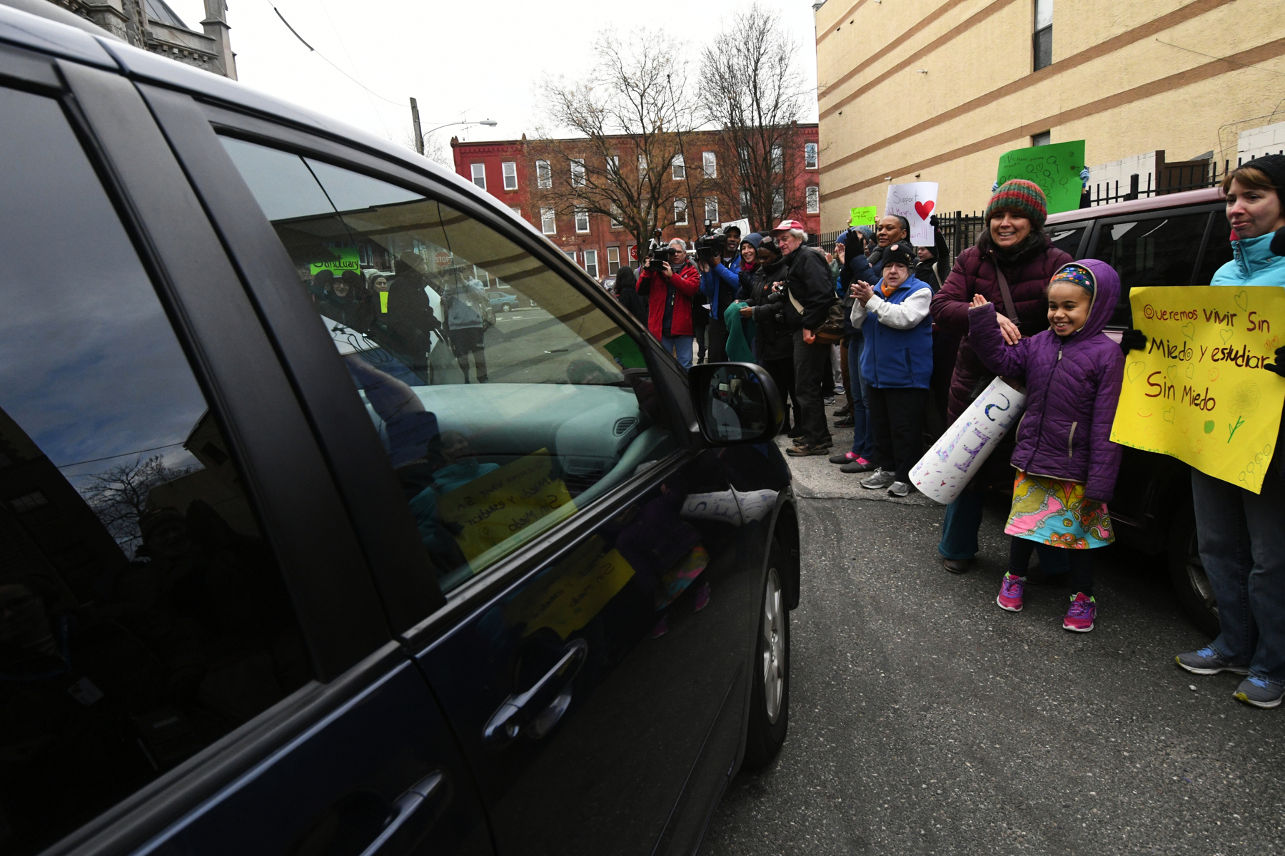 The four undocumented children of Camela Apolonio Hernandez are cheered as they leave sanctuary at Church of the Advocate in North Philadelphia to go to school.