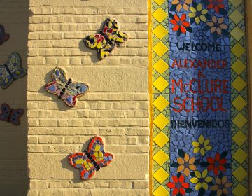 A five-year mural project covers the facade of the McClure School in North Philadelphia with colorful mosaics designed by students.