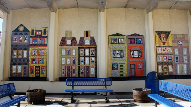 Colorful row houses on the McClure School facade show what the students think might be going on inside.
