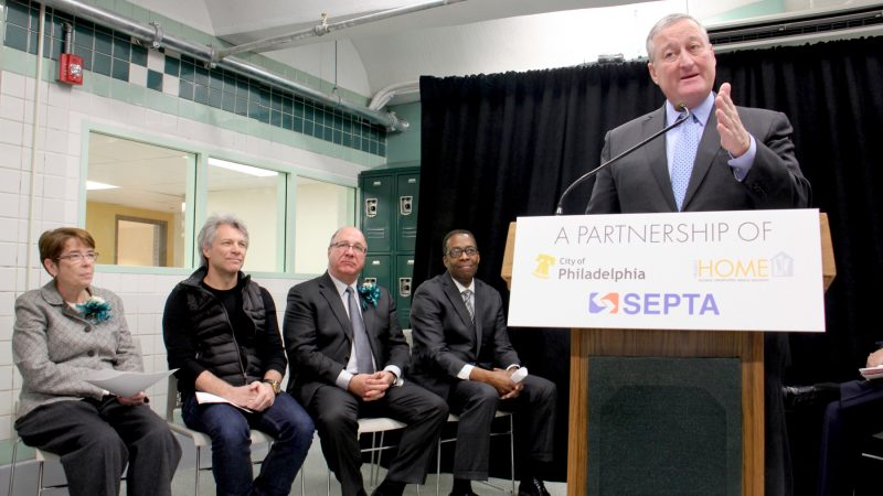 Philadelphia Mayor Jim Kenney speaks at the ribbon cutting for Hub of Hope. Seated (from left) are Sister Mary Scullion of Project HOME, rocker philanthropist Jon Bon Jovi, SEPTA Board Chairman Pasquale T. Deon Sr., and City Council President Darrell Clarke. (Emma Lee/WHYY)