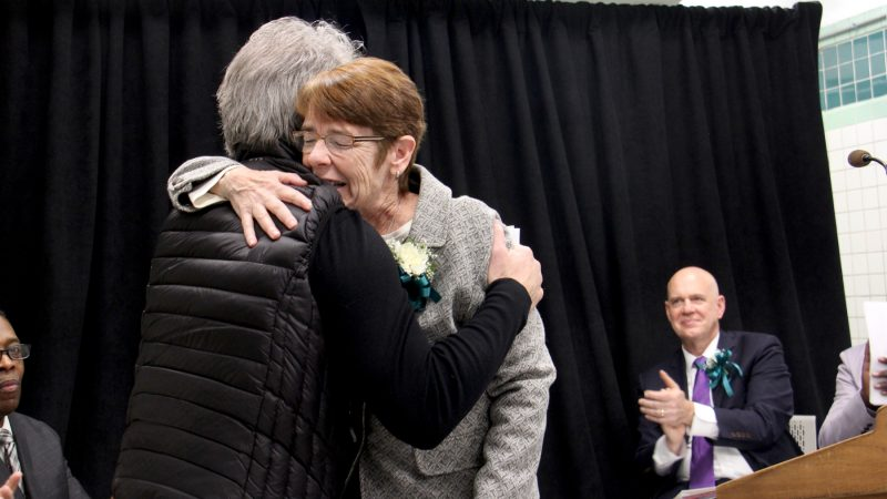 Sister Mary Scullion of Project HOME embraces Joh Bon Jovi, whose Soul Foundation has helped to alleviate homelessness in Philadelphia. The two celebrated the opening of Hub of Hope, a service center for homeless people located in the Center City subway concourse. (Emma Lee/WHYY)