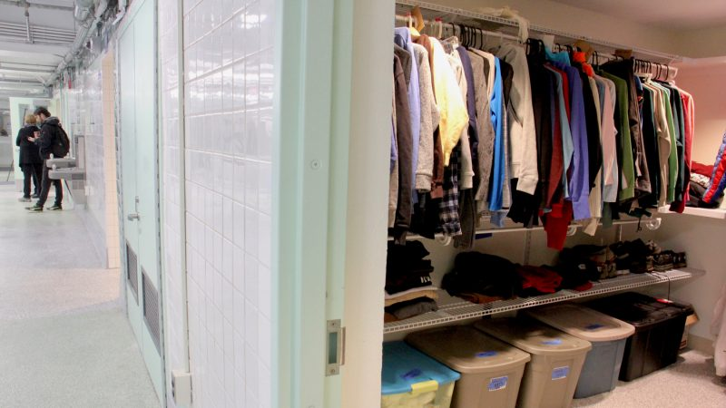 A spacious walk in closet at Hub of Hope is filled with donated clothing. (Emma Lee/WHYY)