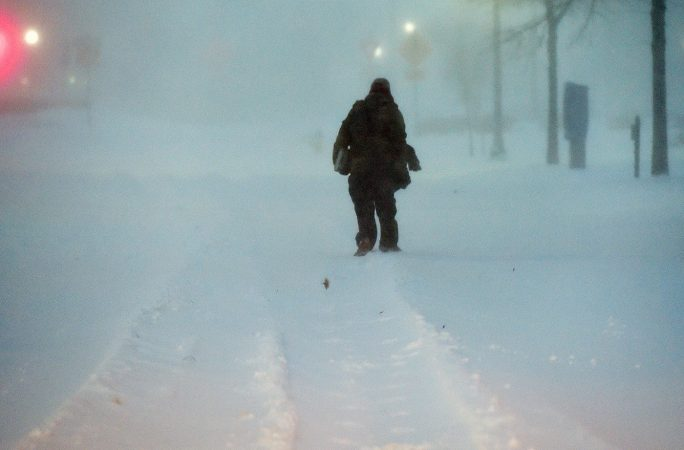 With heavy snow covering the roads in Sussex County, Delaware, some opted to travel by foot. (Chuck Snyder/for WHYY)