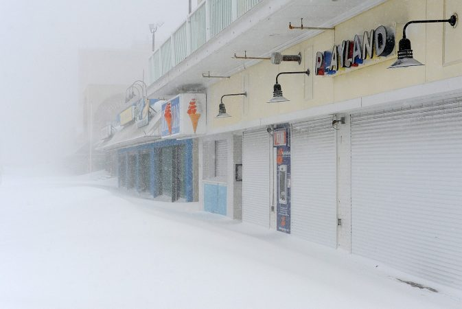 Businesses remained shuttered along the Rehoboth Beach boardwalk as blizzard-like conditions moved in overnight. (Chuck Snyder/for WHYY)