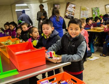 Francis Scott Key Elementary kindergartners and 1st graders picked up breakfast items on Jan. 9 to eat in the cafeteria. Older students eat in classrooms. At a news conference at Key that day, officials celebrated the results of the District's expanded breakfast program. (Darryl Murphy/The Notebook)
