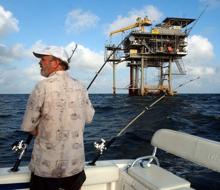 FILE - In a  in this Friday, May 9, 2003 file photo, angler Andy Hails, of Montgomery, Ala., checks the fishing lines on his boat as he trolls the Gulf of Mexico near a natural gas well off the Alabama coast near Gulf Shores, Ala. President Obama announced his new offshore drilling policy Wednesday, March 31, 2010. (AP Photo/Dave Martin, File)