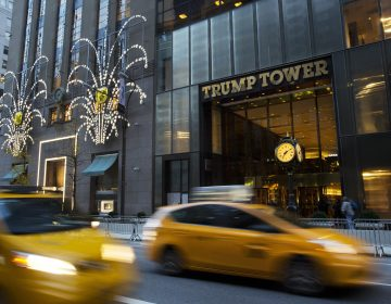 Traffic passes Trump Tower, Monday, Nov. 21, 2016, in New York.