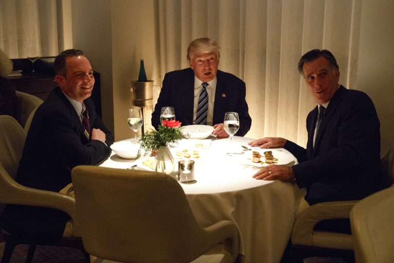 President-elect Donald Trump, center, eats dinner with Mitt Romney, right, and Trump Chief of Staff Reince Priebus at Jean-Georges restaurant, Tuesday, Nov. 29, 2016, in New York.