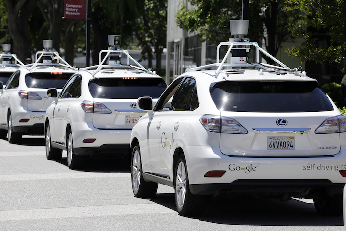 FILE - This May 13, 2014, file photo shows a row of Google self-driving Lexus cars at a Google event outside the Computer History Museum in Mountain View, Calif. California regulators release safety reports filed by 11 companies that have been testing self-driving car prototypes on public roads on Wednesday, Feb. 1, 2017. The papers report the number of times in 2016 that human backup drivers took control from the cars' self-driving software, though companies argue such