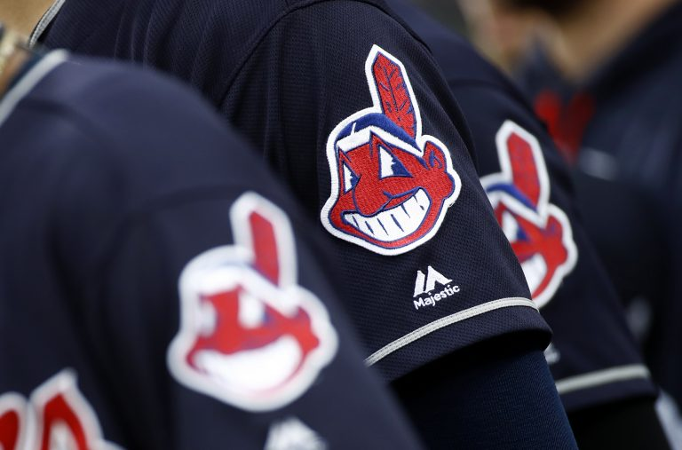 Members of the Cleveland Indians wear uniforms featuring mascot Chief Wahoo as they stand on the field for the national anthem before a baseball game against the Baltimore Orioles in Baltimore, Monday, June 19, 2017.