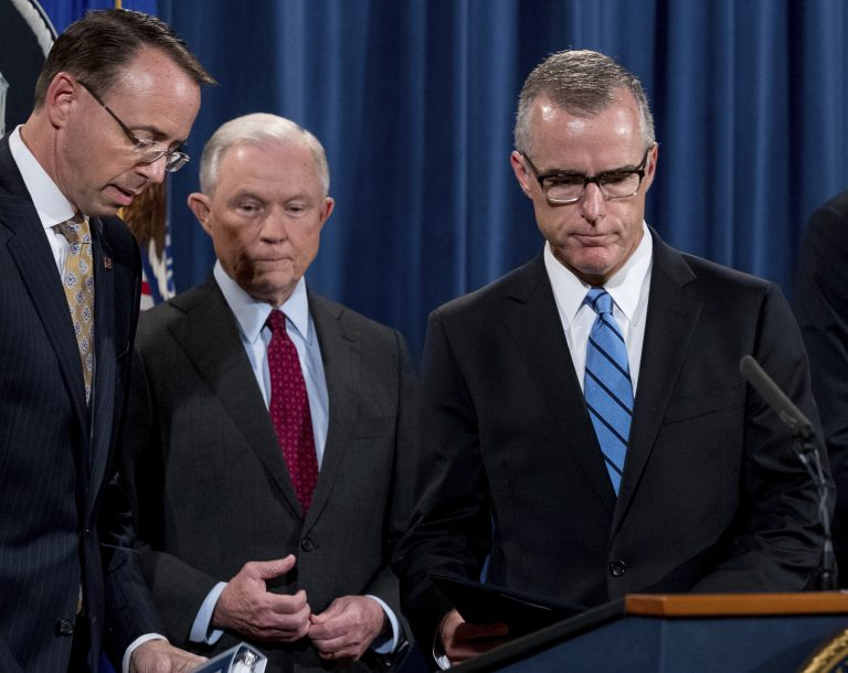 FBI Acting Director Andrew McCabe, right, accompanied by Attorney General Jeff Sessions, second from left, Deputy Attorney General Rod Rosenstein, takes the podium at a news conference to announce an international cybercrime enforcement action at the Department of Justice, Thursday, July 20, 2017, in Washington.
