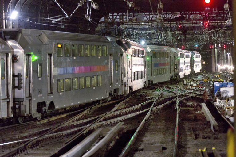 In this Tuesday, July 25, 2017 photo, a New Jersey Transit train traverses the tracks in New York's Penn Station.