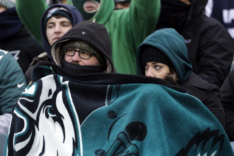 Philadelphia Eagles' fans huddle during the second half of an NFL football game against the Dallas Cowboys, Sunday, Dec. 31, 2017, in Philadelphia.
