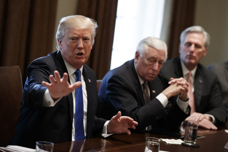 President Donald Trump speaks during a meeting with lawmakers on immigration policy in the Cabinet Room of the White House, Tuesday, Jan. 9, 2018, in Washington. From left, Trump, Rep. Steny Hoyer, D-Md., and Rep. Kevin McCarthy, R-Calif.