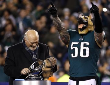 Philadelphia Eagles' Chris Long wears a mask after the NFL football NFC championship game against the Minnesota Vikings Sunday, Jan. 21, 2018, in Philadelphia. The Eagles won 38-7 to advance to Super Bowl LII. (AP Photo/Patrick Semansky)