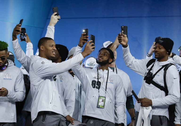 Philadelphia Eagles players take pictures during NFL football Super Bowl 52 Opening Night Monday, Jan. 29, 2018, at the Xcel Center in St. Paul, Minn.