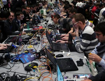 Hackers take part to a test at the Cybersecurity Conference in Lille, northern France, Wednesday Jan. 25, 2017.  (AP Photo/Michel Spingler)