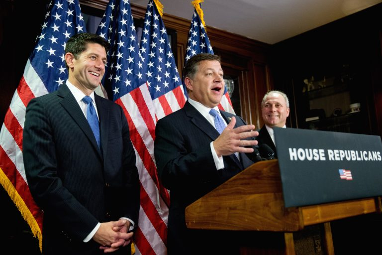 House Transportation Committee Chairman Rep. Bill Shuster, R-Pa., center, accompanied by House Speaker Paul Ryan of Wis., left, and House Majority Whip Steve Scalise of La., right, speaks during a news conference on Capitol Hill in Washington, Tuesday, Nov. 3, 2015.