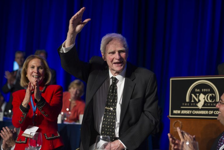 Former N.J. Gov. Brendan Byrne waves as the audience sings him Happy Birthday, as his wife Ruthi Zinn Byrne applauds, for his 90th birthday during the N.J. State Chamber of Commerce annual Congressional Dinner in Washington, Tuesday, April 22, 2014. (AP Photo/Cliff Owen)