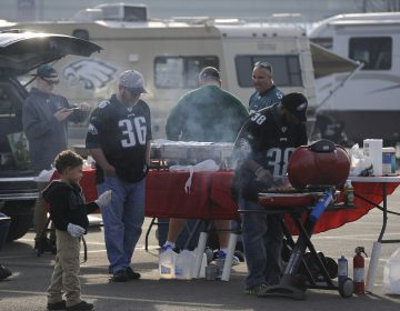 Fans tailgate before an NFL football game in Philadelphia.