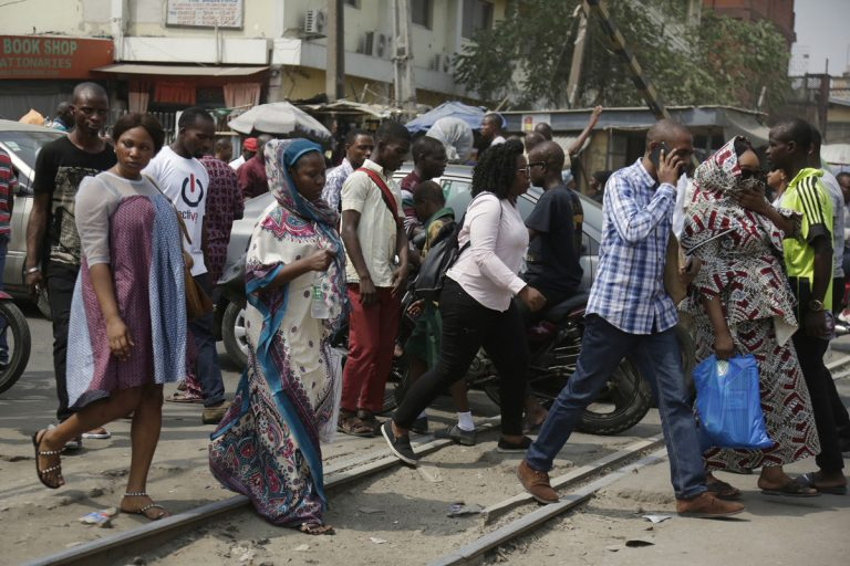 Pedestrian cross a rail line in Lagos, Nigeria, Friday, Jan. 12, 2018. Africans were shocked on Friday to find President Donald Trump had finally taken an interest in their continent. But it wasn't what people had hoped for. Using vulgar language, Trump on Thursday questioned why the U.S. would accept more immigrants from Haiti and