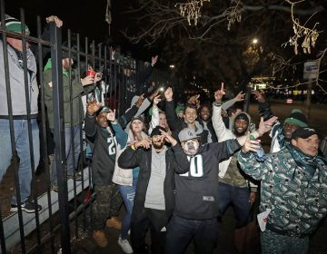 Fans celebrate outside Lincoln Financial Field after the NFL football NFC championship game between the Philadelphia Eagles and the Minnesota Vikings Sunday, Jan. 21, 2018, in Philadelphia. The Eagles won 38-7 to advance to Super Bowl LII. (Matt Slocum/AP Photo)