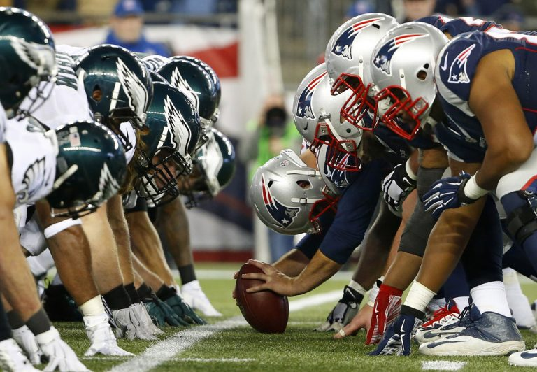 In this Dec. 6, 2015, file photo, the New England Patriots and the Philadelphia Eagles get set for the snap at the line of scrimmage during an NFL football game at Gillette Stadium in Foxborough, Mass. (Winslow Townson/AP Images for Panini via AP, File)