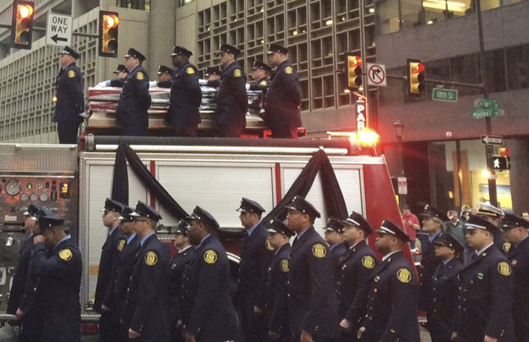 Firefighters line up as the body of Philadelphia firefighter Lt. Matthew LeTourneau is carried on top of a firetruck during a funeral procession on Friday, Jan. 12, 2018 in Philadelphia. Officials say the funeral mass for Lt. Matthew LeTourneau will be held Friday at the Cathedral Basilica of Saints Peter and Paul in Philadelphia. The 11-year veteran was pulled from the home on Saturday by fellow firefighters and taken to a hospital, where he was later pronounced dead.