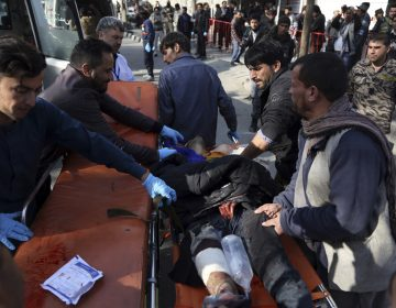 An injured man is moved to a stretcher outside a hospital following a suicide attack in Kabul, Afghanistan, Saturday Jan. 27, 2018. A suicide car bomber killed at least 40 people and wounded about 140 more in an attack claimed by the Taliban on Saturday in Afghanistan's capital Kabul, authorities said. (Rahmat Gul/AP Photo)