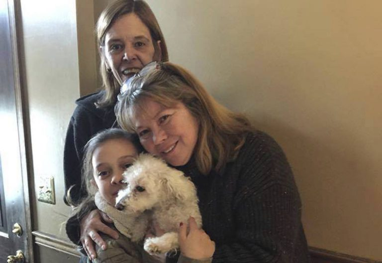 In this photo provided by Jessica Hartman, Monica Newhard, (right), and her granddaughter, Helen Welch, hold their pet bichon frise, Zoey, as the dog's rescuer, Christina Hartman, stands behind them, Wednesday, Jan. 3, 2018, in Palmerton, Pa. Newhard's brother says an eagle snatched Zoey from the yard. (Jessica Hartman via AP)