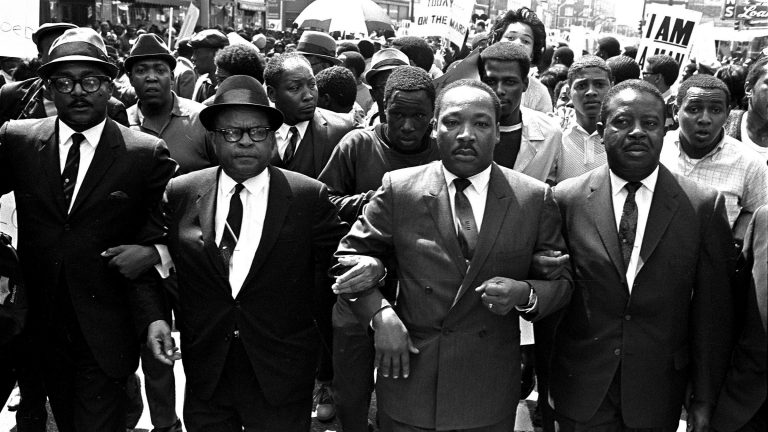 The Rev. Ralph Abernathy, right, and Bishop Julian Smith, left, flank Dr. Martin Luther King, Jr., during a civil rights march