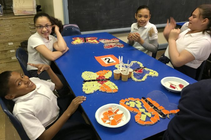 McClure students create mosaic butterflies for the