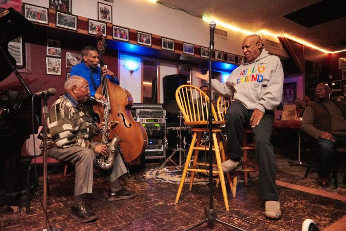 Bill Cosby talks to the band while performing in Germantown Monday night