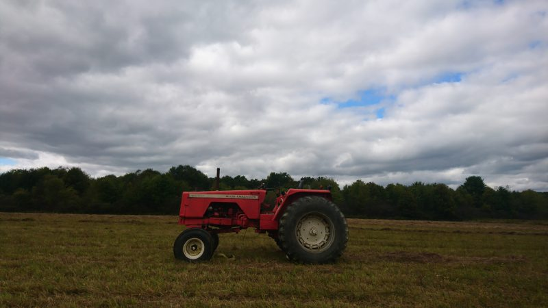 A tractor sits in an empty field on the outskirts of the Titusville School District (Kevin McCorry/Keystone Crossroads)